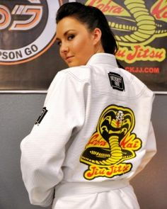 Sim Go - Cobra Kai Jiu Jitsu Gi by Submit One (Back) - offered in White & Blue (with or without the Cobra Logo)