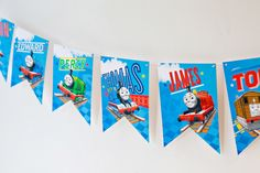 Thomas & Friends Birthday Banner This printable banner is party-ready with Thomas and his steam team friends! Print and cut the panels out, then use a small hole punch on the top corners of each panel. Thread the banner using twine.