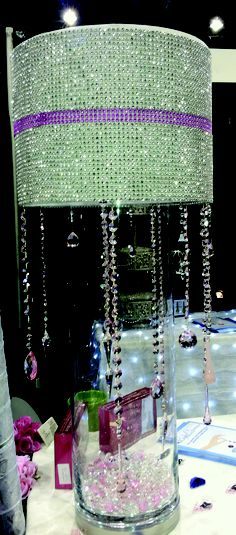 Magnetically tipped crystals attached to a lampshade (all lampshades have a metal rim around the bottom.  The shade is put over a vase and the crystals make for a beautiful waterfall effect.   MAGTRIM TRIM DESIGNS