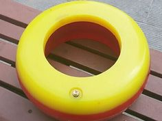 A yellow and red integral inflatable thread protector is on a chair.