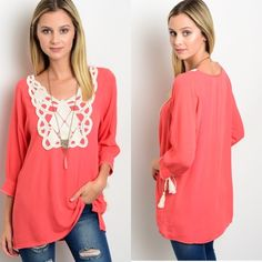 Coral Peasant Boho Top Coral peasant top featuring tie-able tassel on sleeve cuff. This blouse also has crochet lace patch on bodice and slit on sides. Sizes: S M L leave comment with your size to purchase Tops Blouses