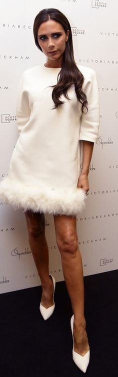 Who made  Victoria Beckham's white feather dress that she wore in Singapore?