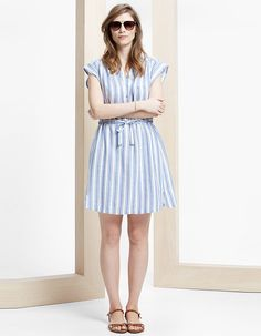 """What could be more perfect for spring than a shirtdress? This striped version from Violeta by MANGO is the perfect balance of feminine and borrowed-from-the-boys. I love that the tie at the waist helps add definition to an otherwise boxy silhouette. The best part is how versatile this piece is—you can easily wear it to work with heels and a blazer or to the beach with sandals, sunglasses and a beachy tote!"" violeta by MANGO Striped Linen Dress via mango.com $109.99"