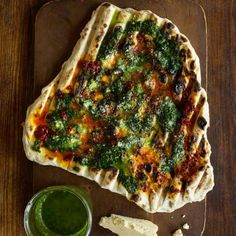 With some drizzled chile oil and herb sauce, these chewy-crisp flatbreads would be just fine on their own. Take it to another level by wrapping them around grilled meats.