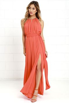 Your presence will be known the second you walk by in the Gleam and Glide Orange Maxi Dress! Lovely woven poly swings from a drawstring halter neckline (with gold accents), into a cutout bodice with plunging V-neck. Elasticized waist with tying sash belt tops the maxi skirt with side slit. Low V-back.
