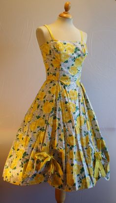 From my own Horrockses collection, a beautiful floral print cotton cocktail dress. My favourite part, which isn't easy to see in the pic, is the scallop detail to the hem, the point of each scallop trimmed with a bow.