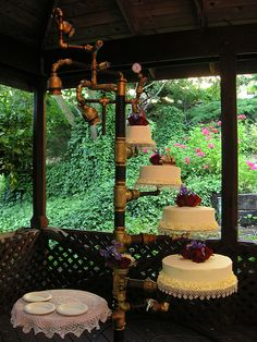 Amazing wedding cake set up by blmurch, via Flickr.  Love the traditional mixed with a dash of Steampunk!