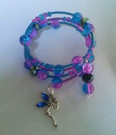 Triple bracelet wiht crackle beads , crystal and swarovski beads , with fairy silverplated charm