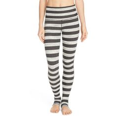 Free People 'Namaste' Stripe Stirrup Leggings ($108) ❤ liked on Polyvore featuring pants, leggings, black combo, swimming pants, heavy leggings, striped pants, free people and legging pants