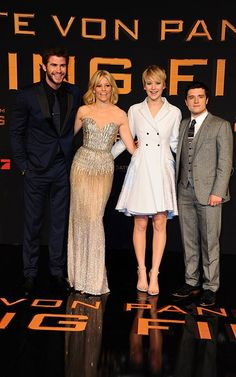 Liam Hemsworth, Elizabeth Banks, Jennifer Lawrence, and Josh Hutcherson at the Catching Fire premiere in Berlin on November 12, 2013.