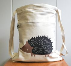 Canvas backpack, hedgehog, cute and adorable. Cinch top, made of 10 oz 100% cotton canvas. $28.00, via Etsy.