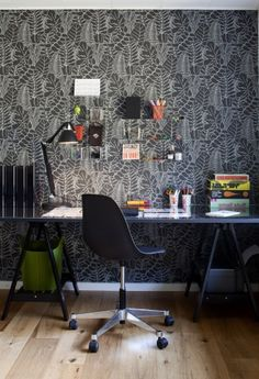 Nice chair, desk and lamp. Wall is too busy.