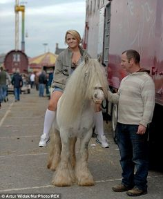 A young woman presents one of her ponies, which she is hoping to sell at the fair...
