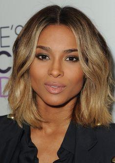 Ciara Medium Hairstyle: Curly Side Part