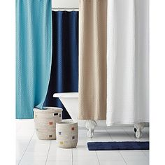 This cotton shower curtain's textural basket weave evokes the luxurious simplicity of classic spa. Pure cotton with buttonhole top.