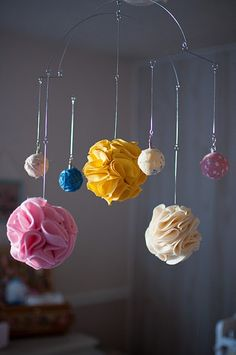DIY mobile with foam balls and fabric! << balls are clipped on, so you can clip anything onto it
