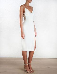 Crepe Harness Midi Dress, from our Spring 16 collection, in Pearl stretch crepe. Harness detail through side of bodice with gold hardware. V neck, shoestring straps. Pencil skirt with side split to thigh. Fully lined with centre back zip closure.