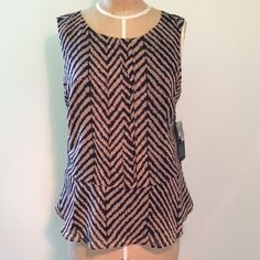 Urban Outfitters- pleated peplum with keyhole! Urban Outfitters- KNT by Kova and T, Black and Tan chevron peplum top with a keyhole at upper back. Urban Outfitters Tops