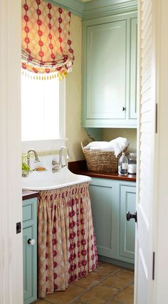 Laundry room, blue cabinets, skirted vintage sink
