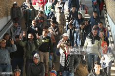 SCHOENEFELD, GERMANY - SEPTEMBER 24: Migrants disembark from a... #schonefeld: SCHOENEFELD, GERMANY - SEPTEMBER 24: Migrants… #schonefeld