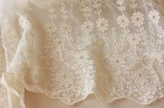 White Cotton Aulic Embroidered Lace Fabric (15.7 Inches Wide 1 yard. 5.99)