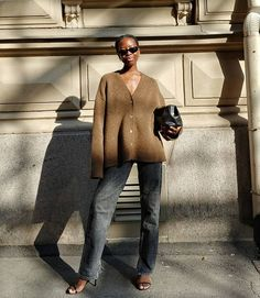 Le Fashion: This Laid-Back Yet Elevated Outfit Idea Is Perfect for Fall — Sylvie Mus in a brown cardigan , black jeans, strappy heeled sandals, '90s-inspired sunglasses, and Demellier London bag