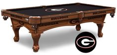 The Georgia Bulldogs Pool Table is available in an 8-ft length. Wood cabinet has CNC and laser cut logos. Available in two finishes. Free installation.  Visit SportsFansPlus.com for Details.