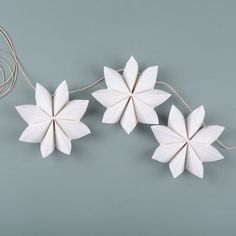 Paper flower garland Here are instructions on how to make a festive garland to brighten up your day. You will need: gram paper, cutting tool, cutting mat, stapler, awl and some string. H… Paper flower garland Here are instruct Flower Garland Wedding, Paper Flower Garlands, Flower Paper, Origami Flowers, Diy And Crafts, Crafts For Kids, Arts And Crafts, Paper Crafts, 1st Grade Crafts