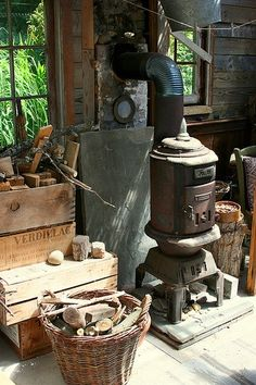 Rustic garden shed heated with wood. I like this idea!