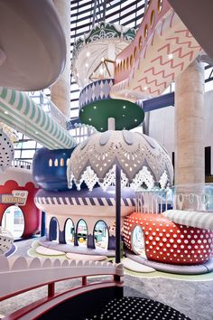 A polka-dot slide into a ball pit and giant pastel parasols feature in a fantastical miniature city called Shenzhen Neobio Family Park, by X+ Living. Shenzhen, Guangzhou, Creative Kids Rooms, Colorful Umbrellas, Play Shop, Park Pictures, Indoor Playground, Hello Sweetie, Kid Spaces