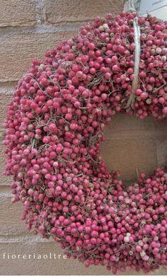 Fioreria Oltre/ Front door wreath/ Pink pepper berry wreath  https://it.pinterest.com/fioreriaoltre/fioreria-oltre-front-door-wreaths/