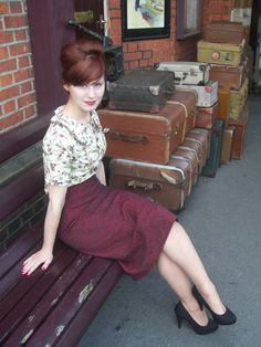 vintage lovely.. love the hair, the pumps,skirt and the luggage!