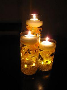 Floating Candle Wedding Centerpiece Kit Orange Lilies LED lights. $55.00, via Etsy.
