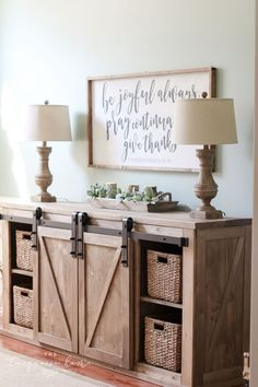 This DIY Farmhouse Media Console Table is both beauty and beast. It is gorgeous with the rustic weathered wood and a beast of a storage unit with two sliding barn doors to cover the junk and four basket drawers to hold even more! And it