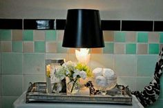 Lamp on tray with toiletries