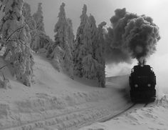 STARK CONTRAST... Pure white snow, stone cold silence = Coal smoke belching display of loud steam power!