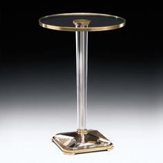 Crystal pedestal table with antiqued brass trim. Hand cast and hand finished in China. 16 in. W x 24 in. H