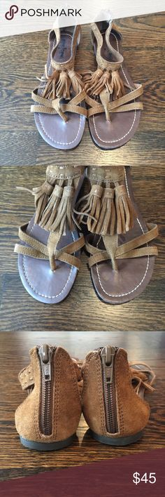 Minnetonka Sandal Brown suede sandal with tassel detail. Worn one time, excellent condition. Minnetonka Shoes Sandals