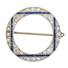 Art Deco Sapphire Diamond Circle Brooch   From a unique collection of vintage brooches at http://www.1stdibs.com/jewelry/brooches/brooches/