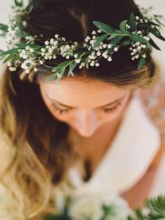 A simple crown of greenery and baby's breath is about as ethereal as you can get, especially when you're all dolled up in a white wedding dress.