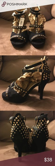 Black open toe gold studded heels New with tags! Super cute black gold studded Heels size 8. They're from torrid so they are Wider then a regular shoe torrid Shoes Heels