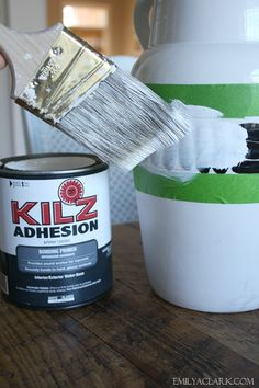 The new Kilz Adhesion Bonding Primer that is a primer that supposedly will adhere to almost anything (laminate, ceramic, etc..).  No need to sand either.