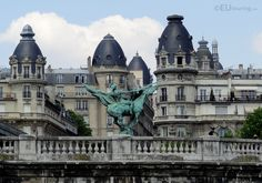 This shot taken of the France Reborn statue that sits on the Pont de Bir-Hakeim sits on a backdrop of incredible architecture and buildings that are found on the other side of the bridge.  See more Paris Photos at www.eutouring.com/images_paris.html