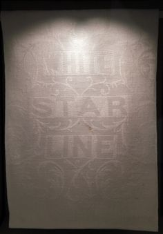 A White Star Line napkin is exhibited at the SeaCity Museum's Titanic exhibition.