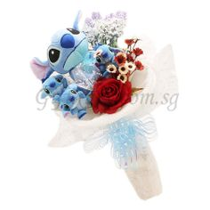 Lilo & Stitch Bouquet With Artificial Flowers http://www.giftxury.com.sg/product/lilo-stitch-bouquet-artificial-flowers/