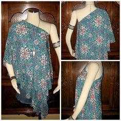 Kaleidoscope' Poncho Hippie Clothing Boho Clothing Upcycled Poncho Bohemian Clothing Upcycled Womens Clothing Ruffled Clothing. $49.00, via Etsy.