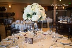 Winery wedding + white + romantic + centerpieces