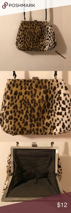Vintage Leopard Minbag/Clutch Great bag. Barely used. In great condition. No longer need. Any questions please ask. Vintage Bags Clutches & Wristlets