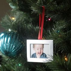 What a good idea! Use dollar store frames to make DIY photo Christmas ornaments - easy & cheap way to decorate your tree! Plus it would be so fun to add new ones year after year.