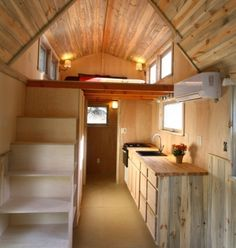 A tiny house on wheels with two lofts and stairs in Felton